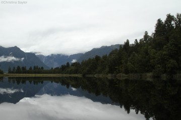 Nature's mirror: admiring the stillness while trekking near Fox Glacier