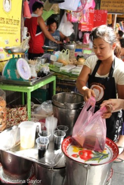 Vendor selling chao kuai or black jelly, which is made from herbs and said to be healthful