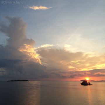 Seeing the sun rise before an early morning dive in Komodo National Park