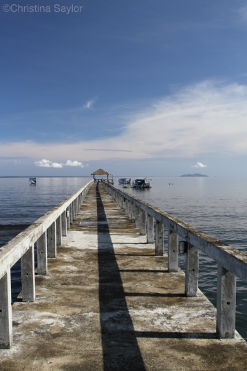 Heading out to the dive boats at the end of the pier on North Sulawesi