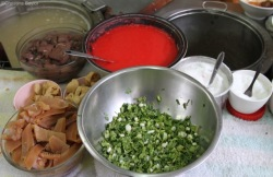 Ta foo is a bright red sauce made from tomatoes and fermented soy