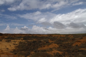 Hiking to the green sand beach on the south coast of the Big Island
