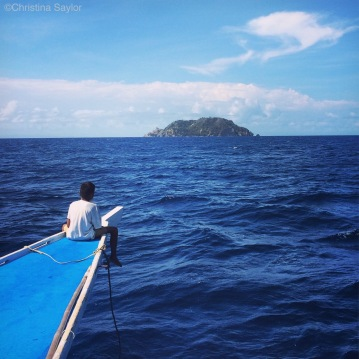 The best seat on the boat... on the way to Apo Island for a day of diving