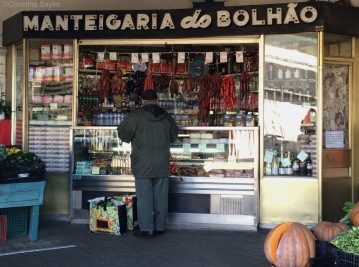 Shopping for sausage at the Mercado do Bolhão in Porto