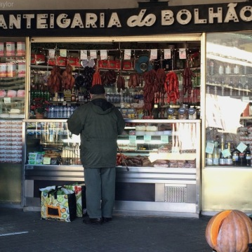 Shopping for sausage at the Mercado do Bolhão in Porto
