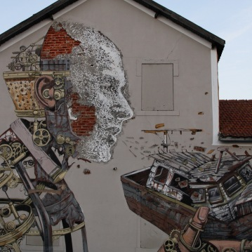 Street art in Lisbon by Pixel Pancho and Vhils