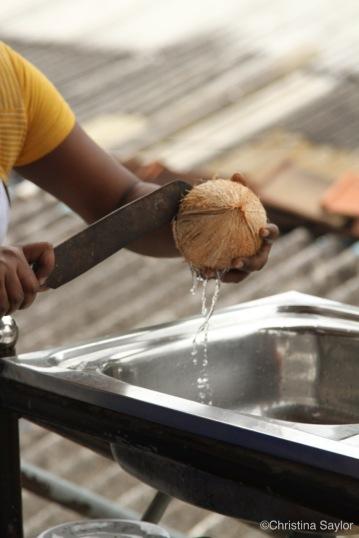 Splitting coconuts in Karuna's cooking class