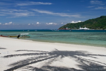 Palm shadows in the hot afternoon sun on Pulau Perhentian Besar