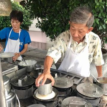 Vendors in the morning making more apam balik (pancakes)