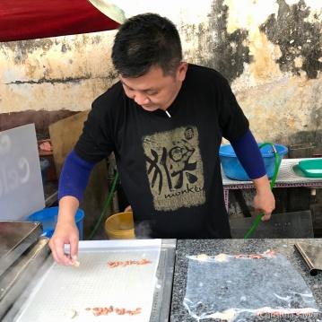 Market vendor making Chee Cheong Fun in Georgetown, Penang