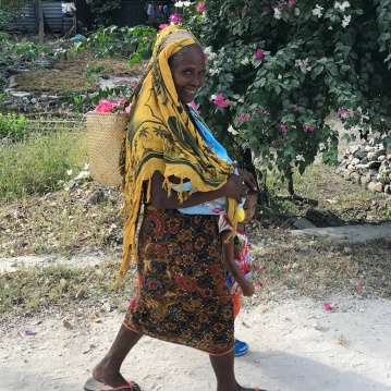 A kind smile from a resident walking to the ceremony for Timor-Leste's Independence Restoration Day