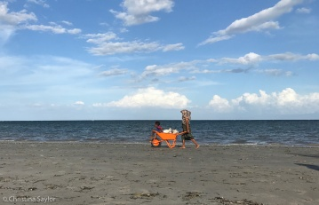 Hard work and a fun ride on the beach near Beloi Village