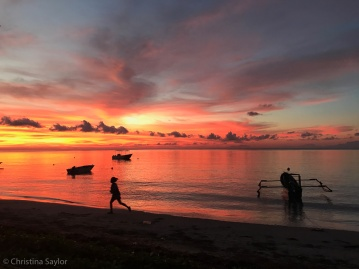 Sunrise on Beloi Beach where the day starts early