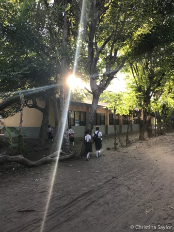 Walking to school in Beloi Village