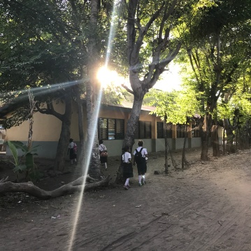 Walking to school in Beloi Village
